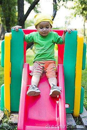 Boy on playground slide