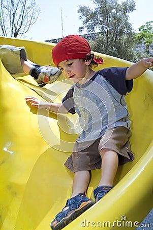 Boy on a playground slide