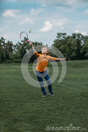 Free Boy Playing Badminton With Racquet And Shuttlecock, On Green Field Stock Images - 97276684