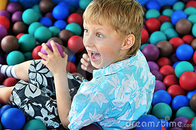 Boy playing with balls