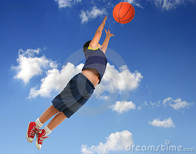 Boy playing basketball. Flying with blue sky