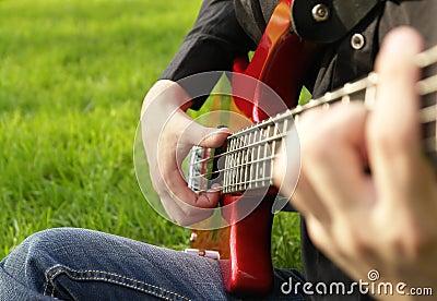 Boy playing the bass guitar