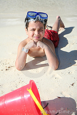 Boy Playing At Beach