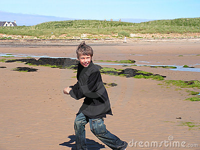 Boy playing on the beach.