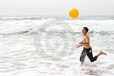 Boy playing beach ball