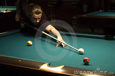 Boy playing billiard