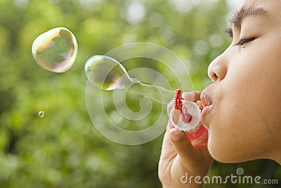 Boy Playing Bubbles