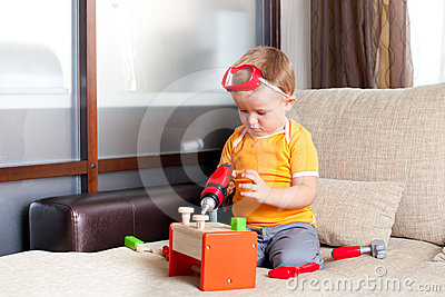 Boy playing with building toys at home