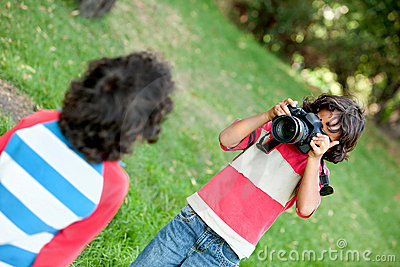 Boy playing with a camera