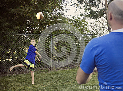 Boy Playing Catch with Dad