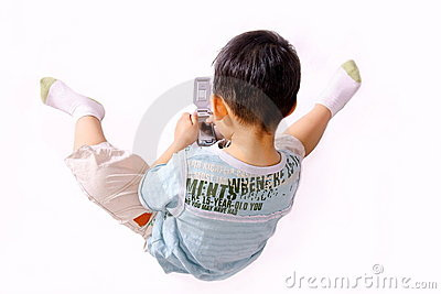 Boy playing with cellphone