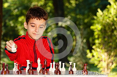 Boy playing chess game