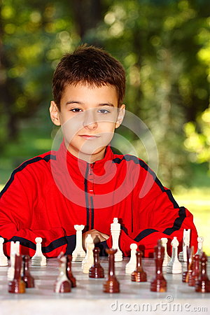 Boy playing chess outdoor