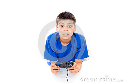 Boy playing computer games on the joystick