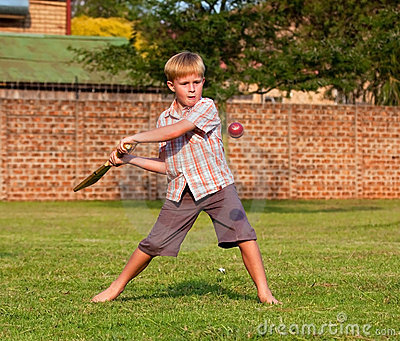 Boy playing cricket in a park