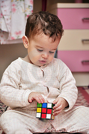 Boy Playing With Cube Toy Stock Photography - Image: 22383192