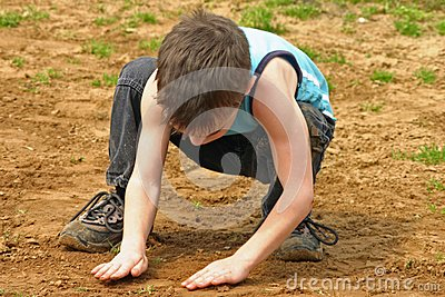Boy Playing in the Dirt