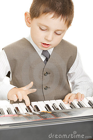 Boy playing electric piano