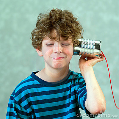 Boy playing with a fake phone