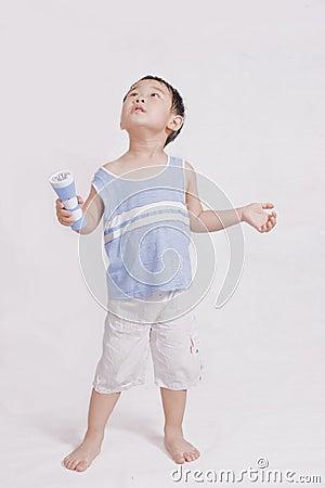 Boy playing with flashlight