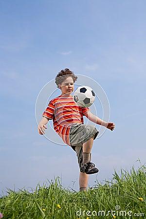 Free Boy Playing Football Royalty Free Stock Photo - 10781165