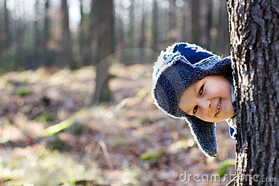 Boy Playing in a Forest