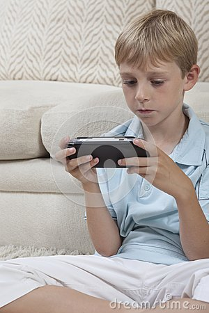 Boy Playing Games On PSP