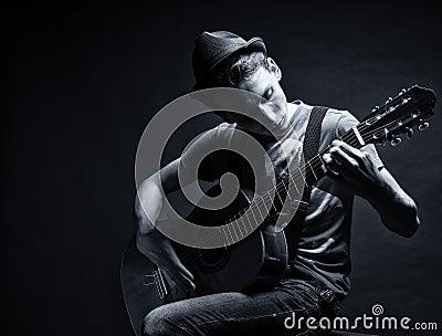 Boy playing gitare