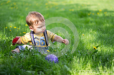 A boy playing on the grass