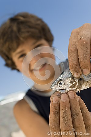 Boy Playing With His Catch