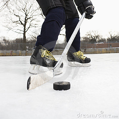 Boy playing ice hockey.