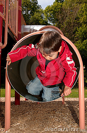 Free Boy Playing In A Tube Slide Stock Image - 5168451
