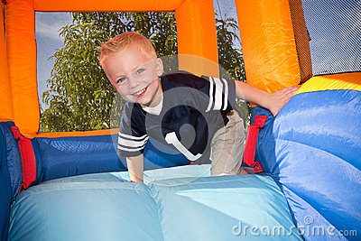 Boy playing on and inflatable Slide