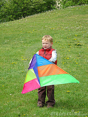 Boy playing with kite