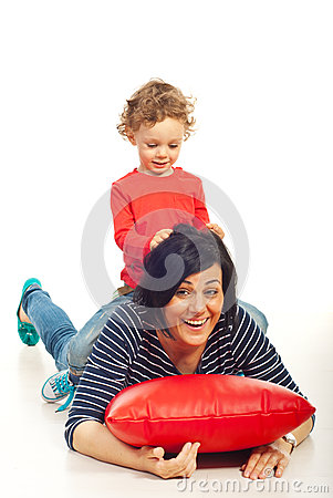 Boy playing with mother