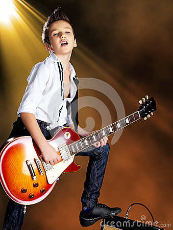 Free Boy Playing On Electric Guitar On The Stage Stock Photos - 33412593