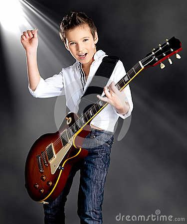 Free Boy Playing On Electric Guitar On The Stage Royalty Free Stock Photography - 36431447