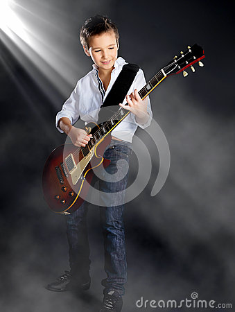 Free Boy Playing On Electric Guitar On The Stage Royalty Free Stock Photos - 36431498