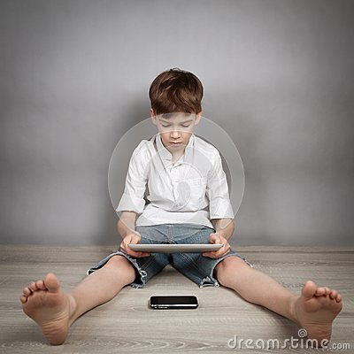 Free Boy Playing On Tablet Stock Photo - 39038800