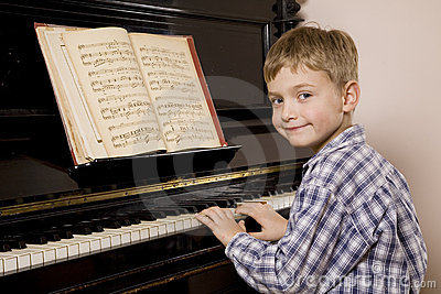 Boy playing the piano