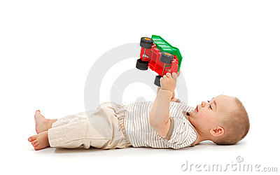 Boy playing with plastic toy car
