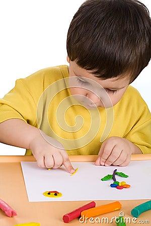 Boy playing with plasticine