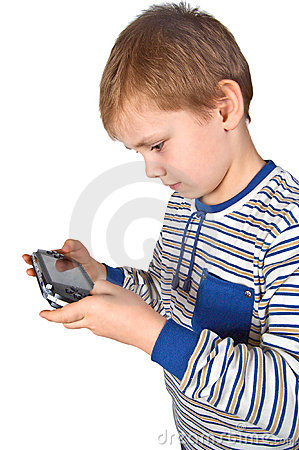 Boy playing psp Editorial Stock Photo