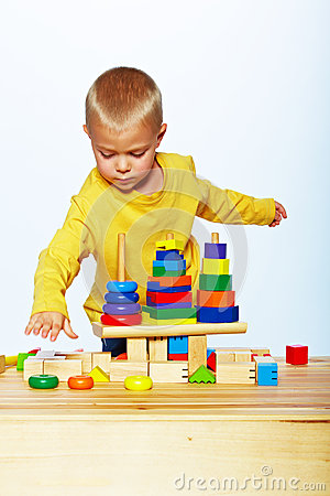 Boy playing with pyramid