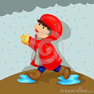 Boy playing in the rain
