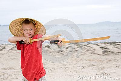 Boy playing with samurai swords made