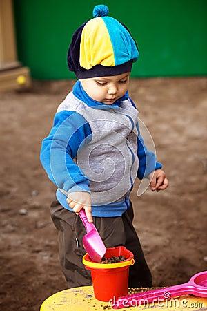 Boy Playing in Sandbox