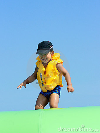 Boy playing at sea