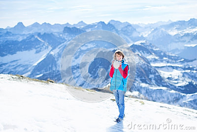 Boy playing snow ball fight in snow mountains