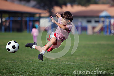 Boy playing soccer in the park